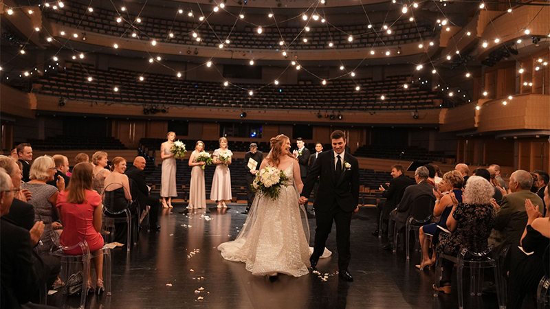 Abby and Tyler Rubeor walk down the aisle