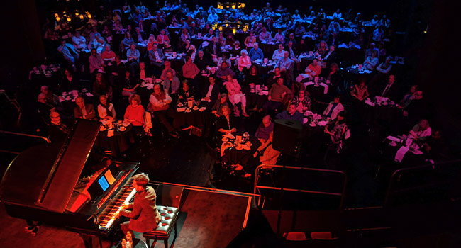 Cabaret Stage with pianist and audience